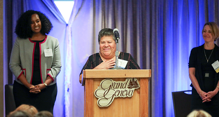 Golla Calvillo of Legal Action of Wisconsin accepts an award at the 2018 Member Recognition Celebration