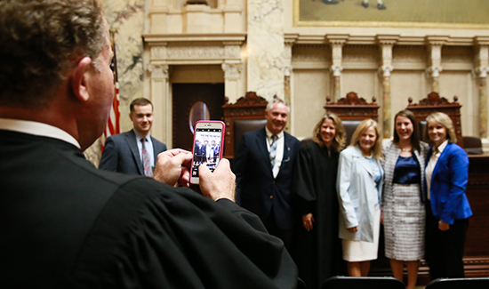 Justice Daniel Kelly takes a photo
