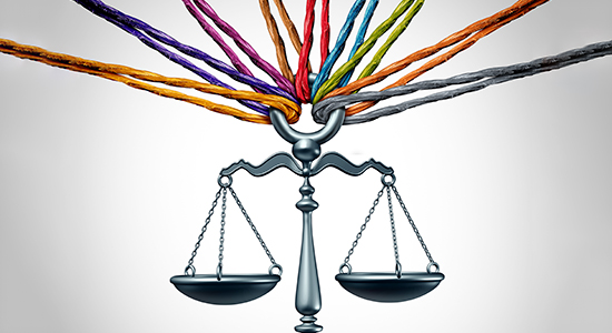 Many colored ropes tied to scales of justice