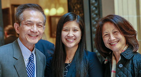 Kristen Chang, center, with her parents Stephen and Vivienne Chang.
