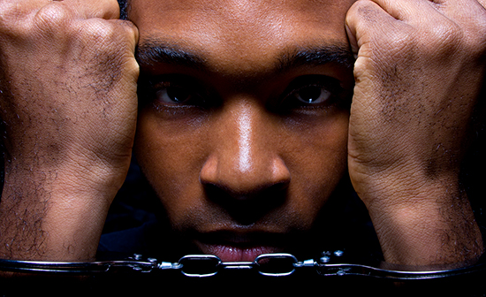 young african-american male in handcuffs