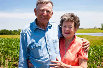 Elderly husband and wife farmers