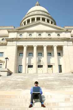 Working on laptop on capitol steps