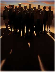 a group of people in shadow