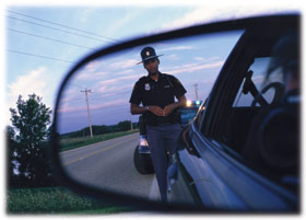officer in rear view mirror