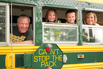 Bob Gagan and family in Packers bus