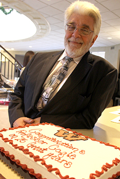 Ralph Cagle with retirement cake