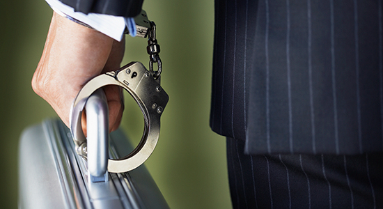 briefcase handcuffed to businessman