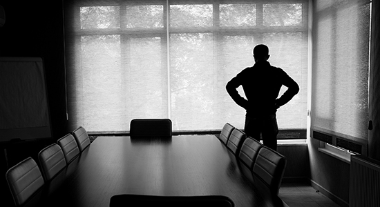 silhouette of business person at conference table