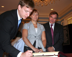 Kyle Hanson signs the Supreme Court Roll
