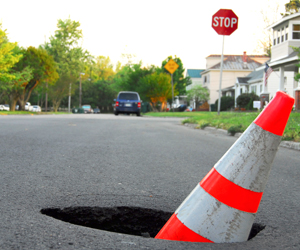 "Pothole liability: Proposed bill could create ""discretionary"" immunity for highway defects"