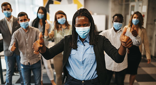 happy employees wearing facemasks
