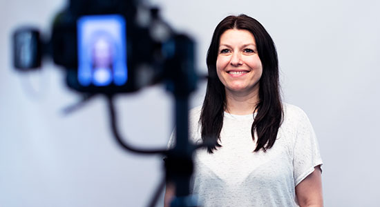 woman in front of camera