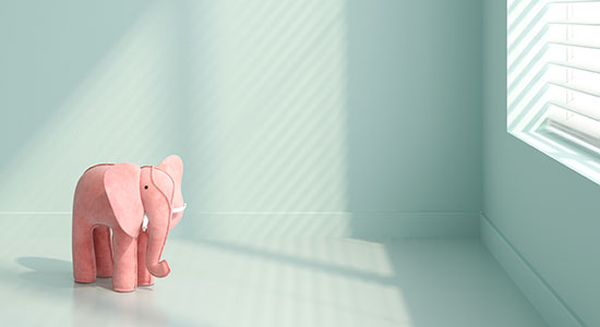 sad stuffed elephant in a room